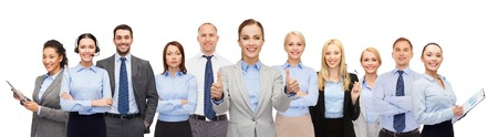 business, people, corporate, teamwork and office concept - group of happy businesspeople showing thumbs up Stock Photo