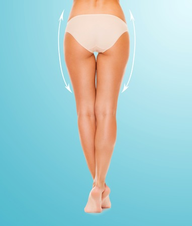 health and beauty concept - woman with long legs in cotton underwear Stock Photo