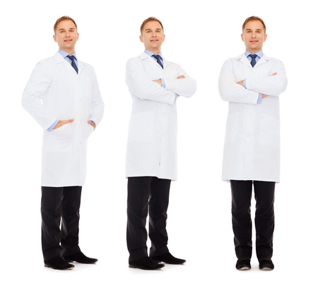 health care and medicine: medicine, science, profession and health care concept - happy doctors in white coat Stock Photo