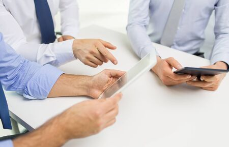 teamwork business: business, people, technology and teamwork concept - close up of businessman hands with tablet pc computer at office Stock Photo