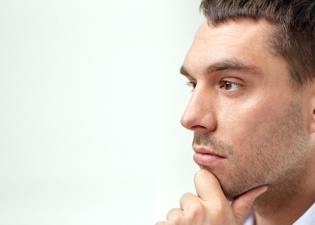 face work: business, people and work concept - close up of businessman male face