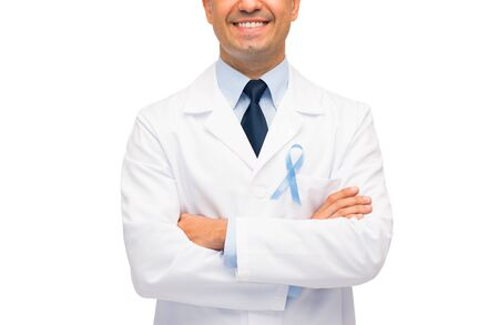 urologist: healthcare, profession, people and medicine concept - close up of smiling male doctor in white coat with sky blue prostate cancer awareness ribbon Stock Photo