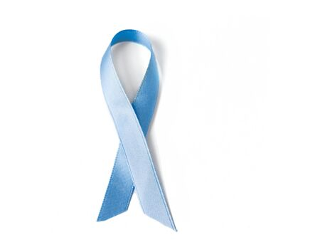 symbolics: medicine, health care and symbolics concept - close up of blue prostate cancer awareness ribbon