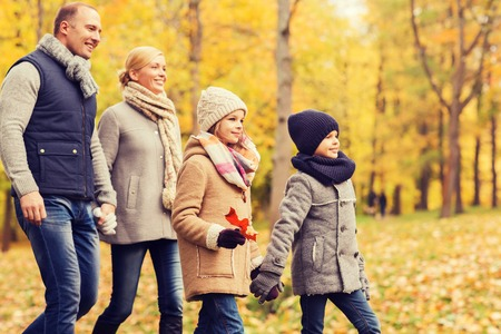 mother love: family, childhood, season and people concept - happy family in autumn park Stock Photo