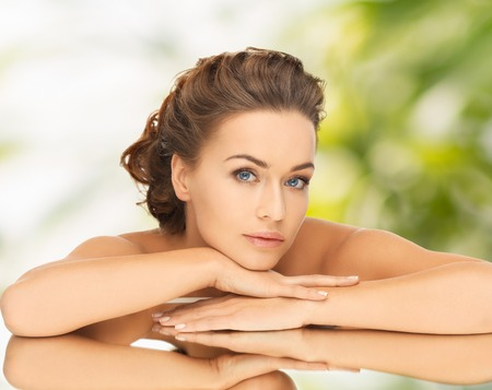 updo: health and beauty concept - dreaming woman with updo and mirror Stock Photo