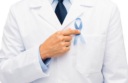 healthcare, profession, people and medicine concept - close up of male doctor hand with sky blue prostate cancer awareness ribbon