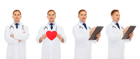 health care and medicine: medicine, profession, cardiology, charity and health care concept - doctors with red heart and clipboard