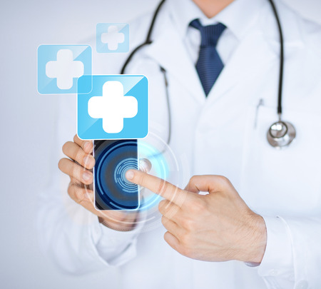 digi: close up of male doctor holding smartphone with medical app
