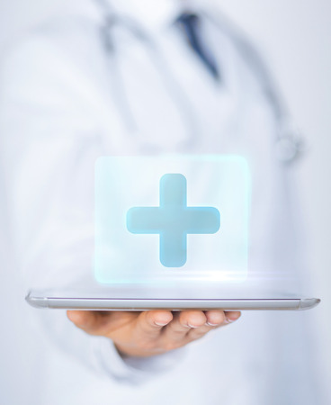 holography: close up of male doctor holding tablet pc with medical app Stock Photo