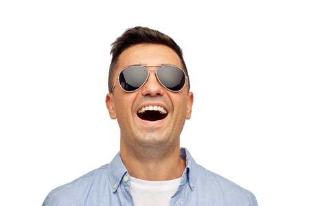 funny glasses: summer, accessories, style and people concept - face of smiling middle aged latin man in shirt and sunglasses