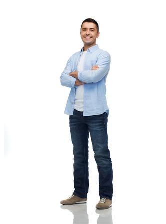 hispánský: štěstí a lidé koncept - usmívající se muž s překřížením rukou Reklamní fotografie