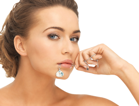 diamond necklace: beautiful woman holding shiny diamond necklace in mouth
