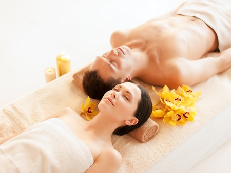 wellness center: picture of couple in spa salon lying on the massage desks