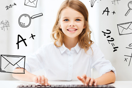 imaginary: education, school and future technology concept - little student girl with keyboard and imaginary screen at school Stock Photo