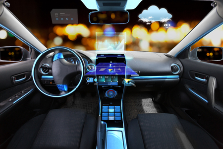 meteo: transport, destination and modern technology concept - car salon with navigation system on dashboard and meteo sensor on windshield over night lights background