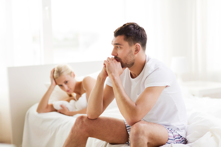 dysfunction: people, relationship difficulties, conflict and family concept - unhappy couple having problems at bedroom Stock Photo