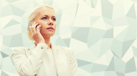 gray: business, technology and people concept - serious businesswoman with smartphone talking over gray graphic low poly background