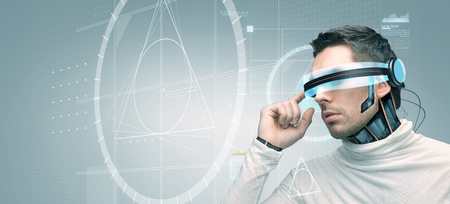 advances: people, technology, future, engineering and progress - man with futuristic 3d glasses and microchip implant or sensors over gray background with golden section on virtual screen