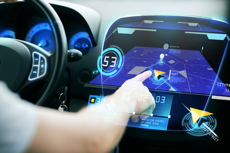 car navigation: transport, destination, modern technology and people concept - male hand searching for route using navigation system on car dashboard screen