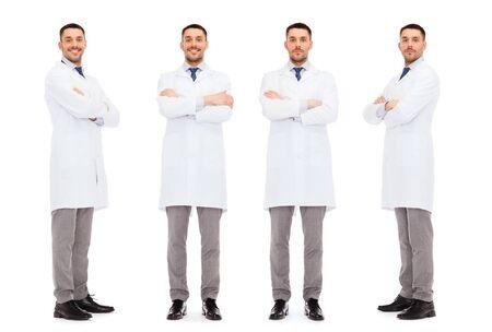 white coat: medicine, science, profession and health care concept - happy doctors in white coat Stock Photo