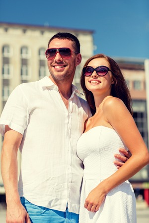 jovenes enamorados: love, travel, tourism, people and friendship concept - smiling couple wearing sunglasses hugging in city