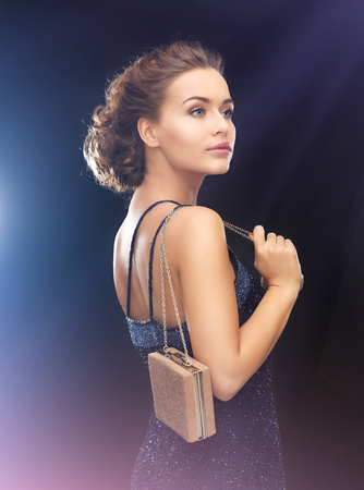 woman bag: beautiful woman in evening dress with small bag