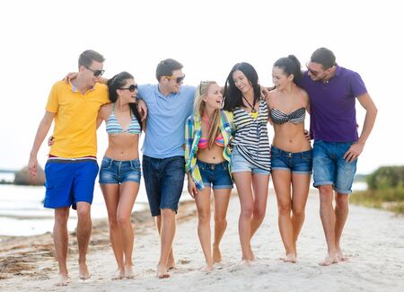 teen bikini: summer holidays, vacation, tourism, travel and people concept - group of happy friends talking and walking along beach