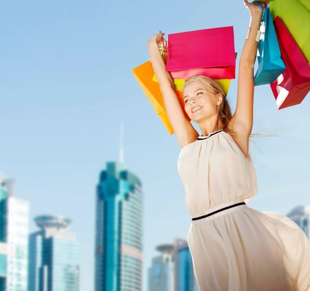 overspending: shopping and tourism concept - woman with shopping bags Stock Photo