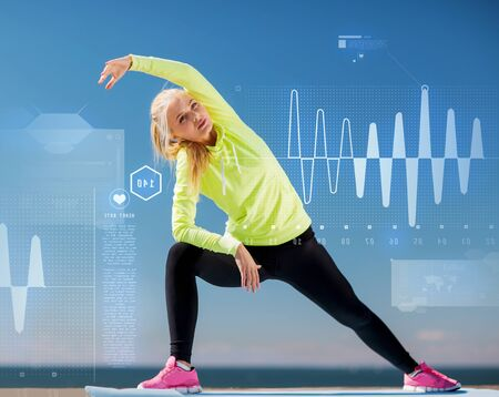 beat: sport and lifestyle concept - woman doing sports outdoors Stock Photo