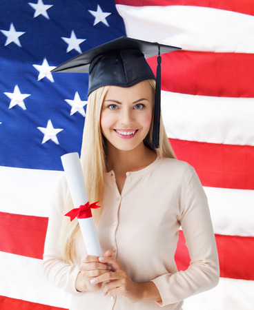 master degree: happy student in graduation cap with certificate over american flag