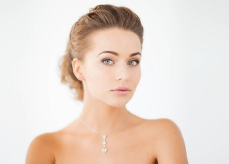 diamond necklace: beautiful woman in white dress with diamond necklace