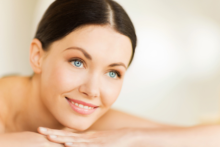 pretty face: picture of woman in spa salon lying on the massage desk