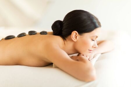 beautiful body: picture of woman in spa salon with hot stones