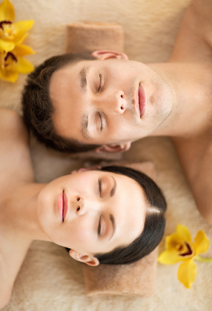 massage spa: picture of couple in spa salon lying on the massage desks