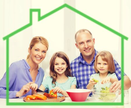 a little dinner: food, family, children, happiness and people concept - happy family with two kids making dinner at home behind green house symbol