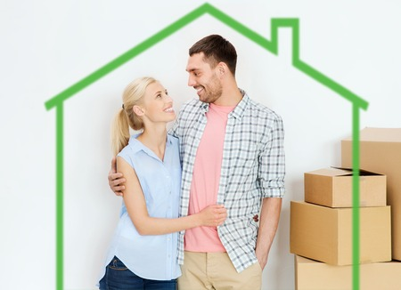 home, people, repair and real estate concept - happy couple with many cardboard boxes moving to new place