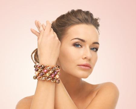 bride bangle: beautiful woman wearing hand jewelry with beads