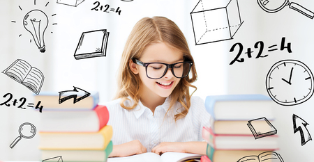 nerd glasses: education and school concept - little student girl studying and reading books at school