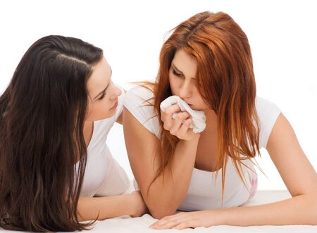 consoling: friendship and happy people concept - one teenage girl comforting another after break up Stock Photo