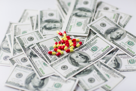 trafficking: medicine, finance, health care and drug trafficking - medical pills or drugs and dollar cash money on table