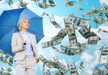 rate: business, economy, finances and people and concept - young businesswoman with umbrella over blue sky and clouds background