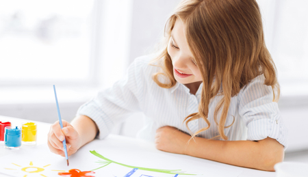 school kit: education, school, art and painitng concept - little student girl painting picture Stock Photo