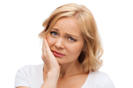 expresiones faciales: las personas, la salud, la odontología y el concepto de problema - mujer infeliz sufrimiento el dolor de muelas Foto de archivo