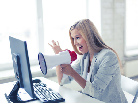 angry teacher: picture of crazy businesswoman shouting in megaphone Stock Photo