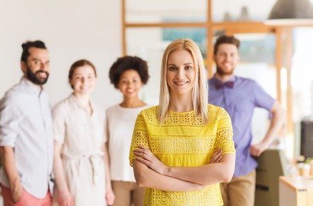students group: business, startup, people and teamwork concept - happy young woman over creative team in office Stock Photo