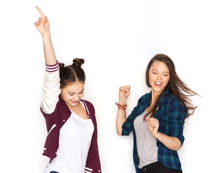 young student: people, friends, teens and friendship concept - happy smiling pretty teenage girls dancing Stock Photo