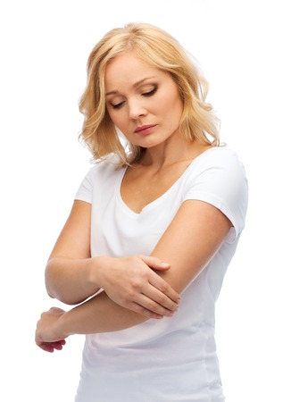middle joint: people, healthcare and problem concept - unhappy woman suffering from pain in hand