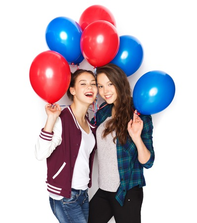 helium: people, friends, teens, holidays and party concept - happy smiling pretty teenage girls with helium balloons