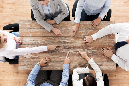 dedo señalando: business, people and team work concept - close up of creative team sitting at table and pointing finger to something in office