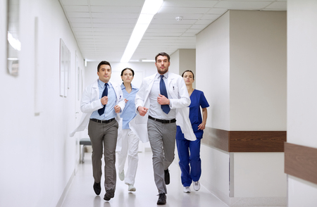 medics: clinic, people, health care and medicine concept - group of medics runing along hospital